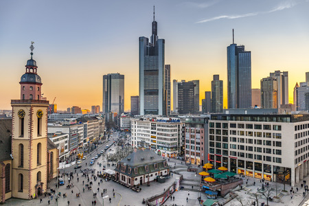 FRANKFURT, GERMANY - MAR 18, 2016: view to skyline of Frankfurt in sunset. Most skyscrapers belong to banks. It is a banking city.