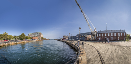 BOSTON, USA - SEP 12, 2017: panorama of empty old wharf in Boston, USA. The navy wharf is nowadays reduced to a small limit of old ships but was until the 60st a very important economic factor in Boston.