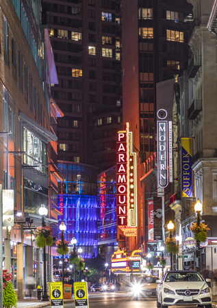 massachussets: BOSTON, USA - SEP 13, 2017: view to famous historic theater district in Boston, Massachussets with ads of Paramount theater. The Paramount opened in 1932 as a 1700-seat, single-screen movie theatre. It was one of the first movie houses in Boston to play t Editorial