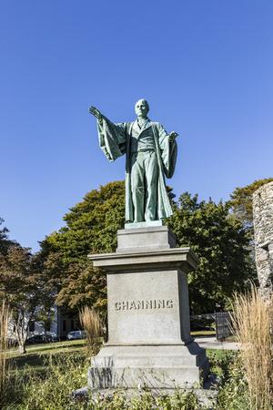 Newport Tower and Channing Statue, Tauro Park, Newport Rhode Island USA. Summer, 2016  newporttowerancientgrainmegalithicmillmysterynew englandoldparkretrorhode islandrockrunestonetauro parktemplarvikingvintage