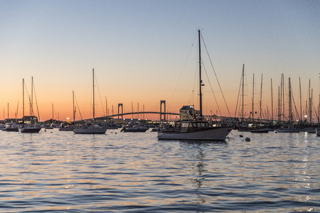 romantic sunset with ships in the harbor of Newport Stock Photo