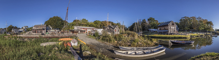 ESSEX, USA - SEP 29, 2017: panoramic river landscape with boats and Essex shipbuilding museum and wharf in ESSEX, New England, USA