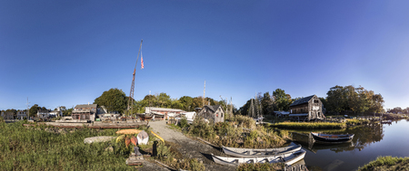 ESSEX, USA - SEP 29, 2017: panoramic river landscape with boats and wharf of Essex shipbuilding museum in New England, USA