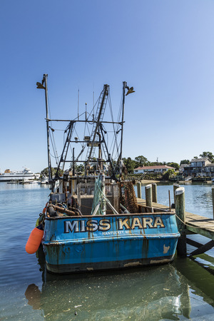 BARNSTABLE, USA - SEP 24, 2017: old lobster fish trawler Miss Kara at the pier in Barnstable harbor. Lobster fishing was in former times the most important industry in Barnstable, USA.