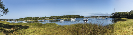 motorboats at the bay in Chatham, Cape Cod with reed grass Stock Photo