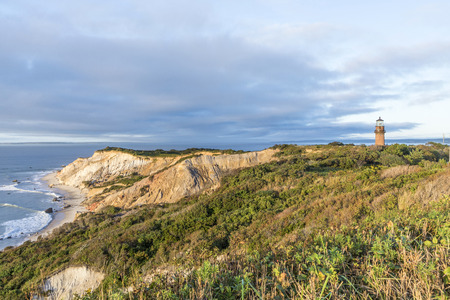 Gay Head Lighthouse and Gay Head cliffs of clay at the westernmost point of Martha's Vineyard in Aquinnah, Massachusetts, USA. This historic lighthouse was built in 1856.