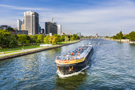 FRANKFURT, GERMANY - AUG 31, 2008: view to river main with boat and skyline  in Frankfurt, Germany. The Main river with a length of 527 km is the most significant right tributary of the Rhine. Editorial