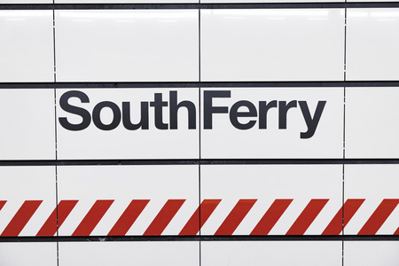 NEW YORK, USA  OCT 5, 2017:  South Ferry sign at a wall. The south ferry is free for everyone and operates every 30 minutes.