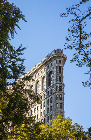 NEW YORK, USA - OCT 5, 2017: detail of Flatiron building from the park at Broadway in New York under blue sky.