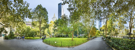 NEW YORK, USA - OCT  5, 2017:  people enjoy the public park at flatiron building downtown New York. New York is also famous for its beautiful parks in Manhattan downtown area.
