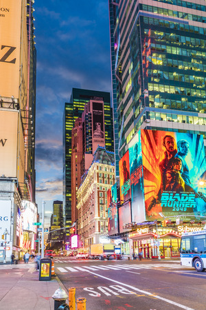NEW YORK, USA - OCT  5, 2017:  neon advertising of News, brands and theaters at times square in early morning. Times square is a symbol for New York life and amusement.