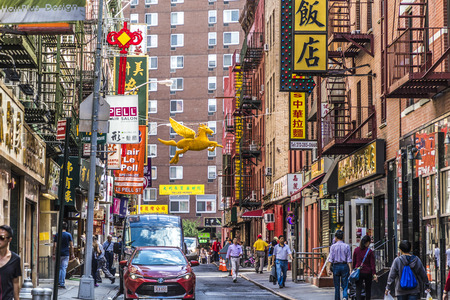 NEW YORK, USA - OCT 5, 2017: chinatown with shops with chinese letters and pegasus in Chinatown, New York.