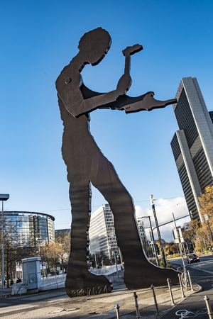 FRANKFURT, GERMANY - NOV 27, 2017:  Kinetic sculpture Hammering Man by Jonathan Borofsky near Frankfurt Messe exhibition area is 21 m high with periodically moving arm holding hammer.