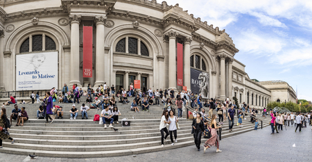 NEW YORK, USA - OCT 6, 2017: people  wait at the Metropolitan museum of Art for entrance and relax at the stairs. The Metropolitan Museum of Art or