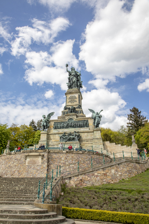 RUDESHEIM, GERMANY - APR 26, 2017: Tourist visiting the Niederwalddenkmal monument located in the Niederwald Landscape park, near Ruedesheim.