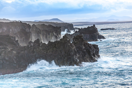 Rough coast with huige waves in Lanzarote Imagens - 92405882