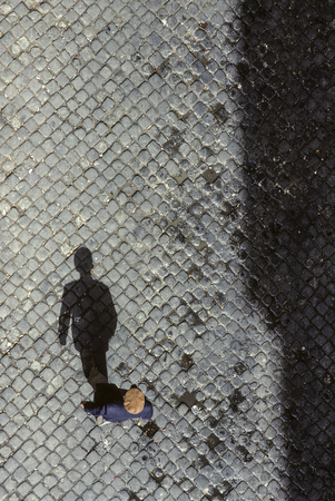 Shadow of senior man on cobble stone in Lisbon