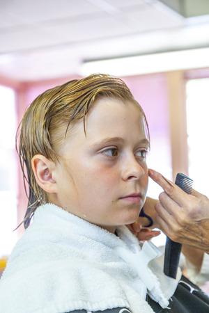 Teenage boy at the hairdresser Stock Photo