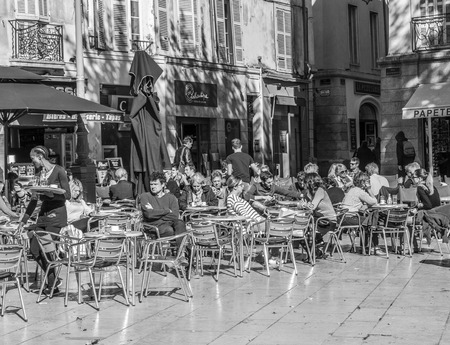 AIX EN PROVENCE, FRANCE - OCT 19, 2016: people enjoy a warm summer day by sitting and meeting in an outdoor bar in Aix en Provence, France.