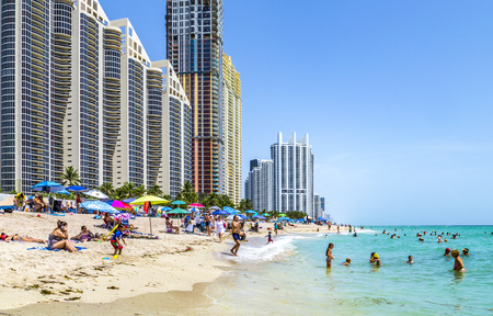 SUNNY ISLES BEACH, USA - AUG 2014: people at Jade beach and Jade Ocean condominiums. Jade Beach and Ocean were completed in 2009 with a elevation of 549 feet.
