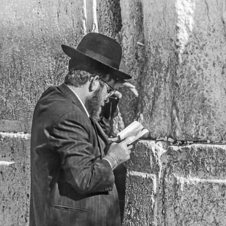 JERUSALEM - JAN 1,1994: Orthodox jewish man prays at the Western Wall in Jerusalem, Israel. Israels annexation of East Jerusalem in 1967, including the Old City, was never internationally recognized.