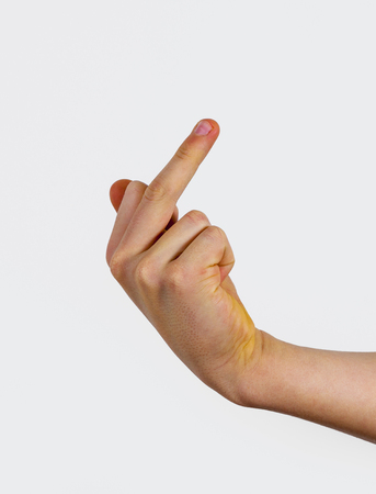 closeup of male hand showing fuck off sign