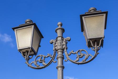 old vintage lantern under blue sky symbolize good former  times Stock Photo