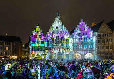 FRANKFURT, GERMANY - MAR 23, 2018: people watch the open air light spectacle Luminale in Frankfurt.  The   Luminale is a Festival of light art which takes place every 2 years in Frankfurt.