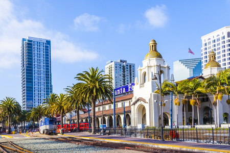 SAN DIEGO, USA - JUNE 11, 2012: train arrives at Union Station  in San Diego, USA. The Spanish Colonial Revival style station opened on March 8, 1915 as Santa Fe Depot.