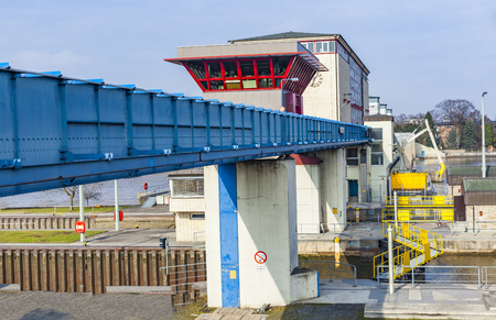 modern watergate griesheim at river Main. This sluice regulates the river Main in Frankfurt area. Banco de Imagens - 99135777
