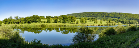 scenic landscape in the french Jura region at river Doubs Stock Photo