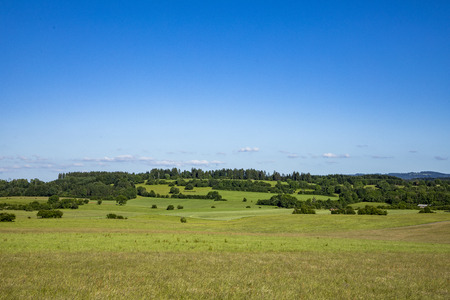 typical rural landscape with meadows and fields in the Jura region, departement Bourgogne, France Stock Photo