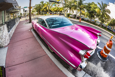 MIAMI, USA - AUG 18, 2014 : Cadillac Vintage car parked at Ocean Drive in Miami Beach, Florida. Art Deco architecture in South Beach is one of the main tourist attractions in Miami