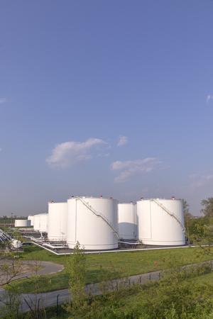white oil tanks under blue sky Foto de archivo - 100309609