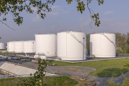 white oil tanks under blue sky Foto de archivo - 100327110
