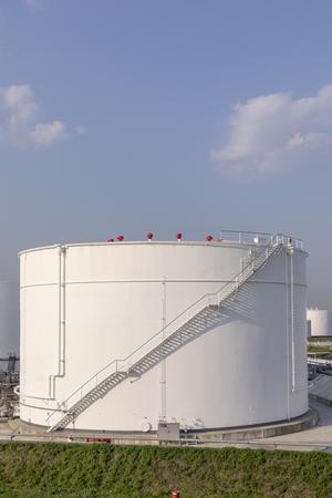 white oil tanks under blue sky Foto de archivo - 100328197