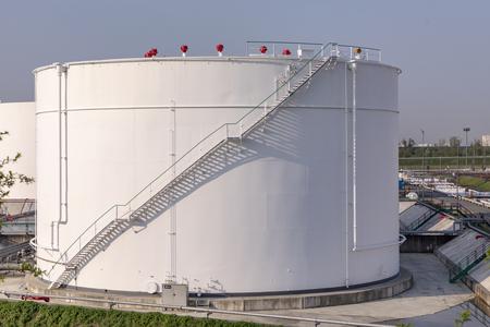 white oil tanks under blue sky Foto de archivo - 100309610