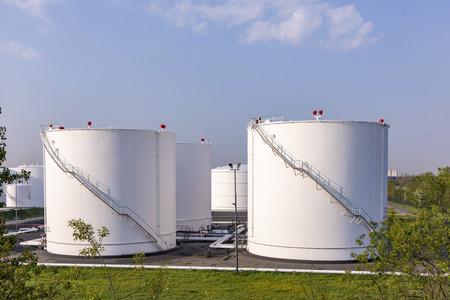white oil tanks under blue sky Foto de archivo - 100378677