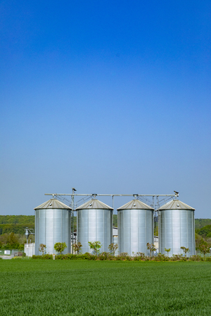 four silver silos at the field