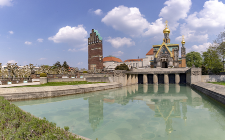 Mathildenhoehe with russian chapel and wedding tower in Darmstadt under blue sky