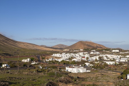 village of Uga in Lanzarote in morning fog with blue sky