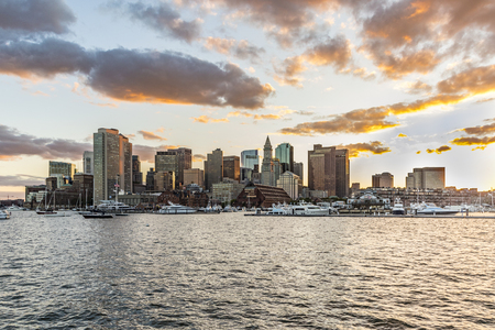 skyline of Boston, USA in sunset with harbor and skyscraper Stock Photo