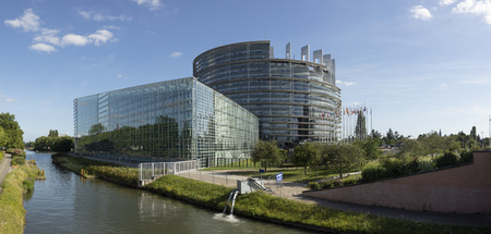 STRASBOURG, FRANCE - JUNE 23, 2018: modern architecture of european union parliament with flags of members in Strasbourg, Alsace, France