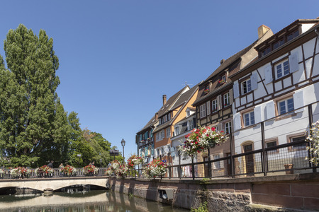 Traditional buildings in the  little Venice area in the old town of Colmar with canal