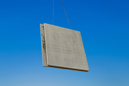 the prefabricated wall is placed at the construction site with help of a huge crane