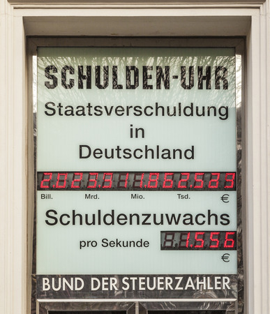 WIESBADEN, GERMANY - NOV 20: clock indicates the actual debt on NOV 20,2011 in Wiesbaden, Germany. The alliance of taxpayer make that debt clock public.