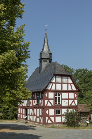 NEU ANSPACH, GERMANY - Jul 16, 2018: old timbered church at the Hessenpark Open-Air Museum