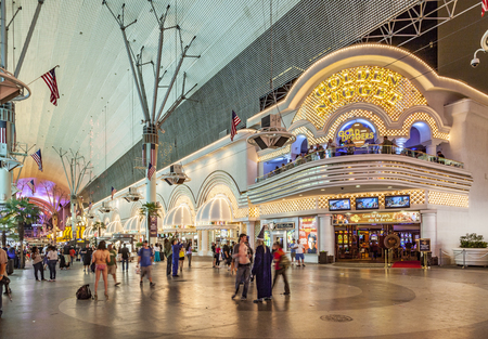 LAS VEGAS, USA - JUNE 16, 2012 : people at Fremont street at Golden Nugget hotel and casino in downtown Las Vegas. The street is the second most famous street in the Las Vegas and dates back to 1905, when Vegas was founded.