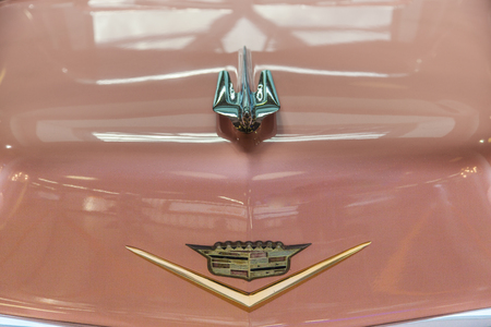 FRANKFURT, GERMANY - JUNE 8, 2012:  pink 1956 Cadillac symbol at the airport in Frankfurt, Germany. It belongs to the museum of Sinsheim with more than 1 Millon visitors per year.