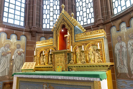 METTLACH, GERMANY - JUL 31, 2018: Church of Lutwinus with golden coffin in Mettlach. In 1722 the church was completely destroyed an rebuilt.
